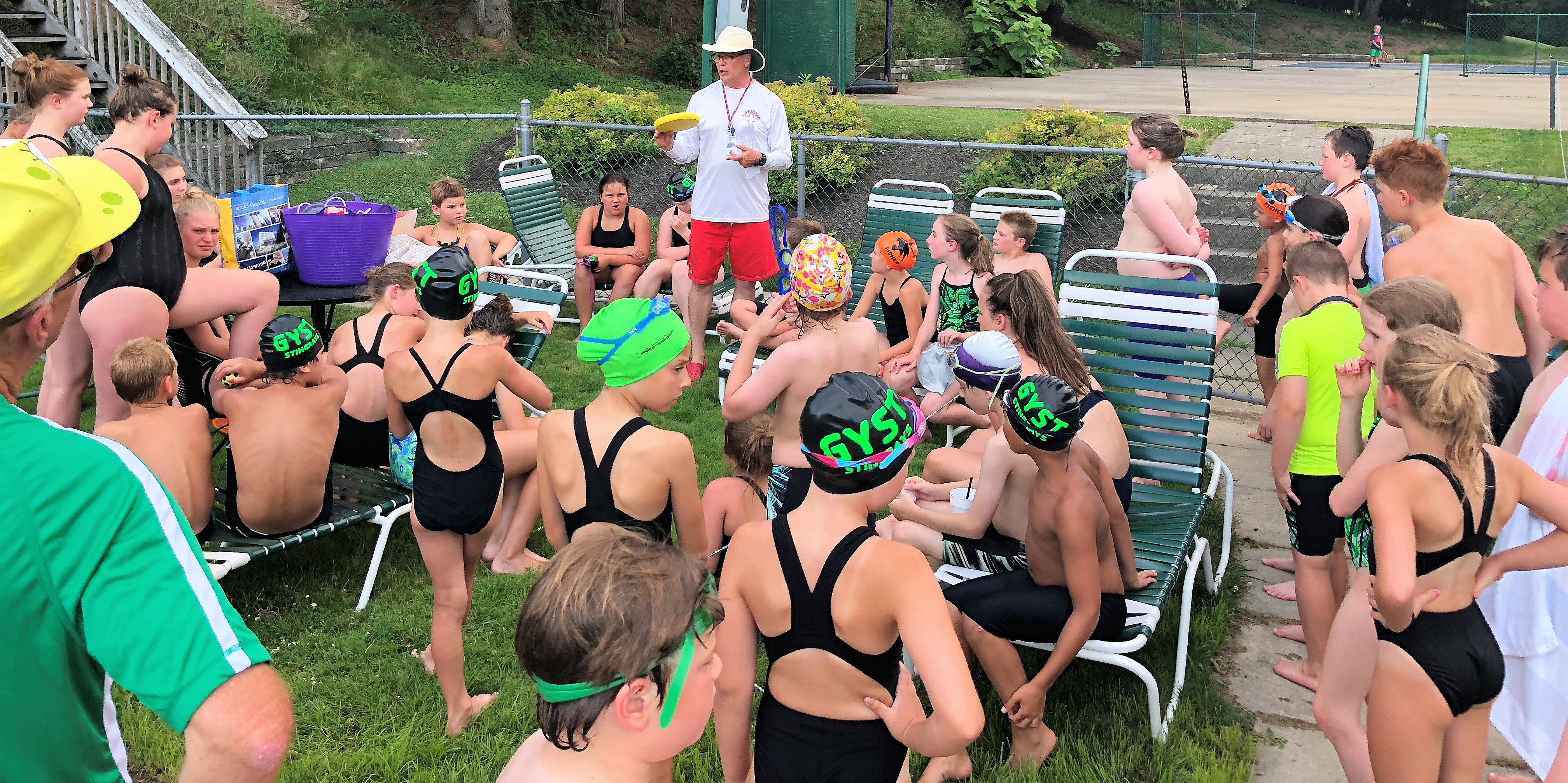 Coach Mark at Greensburg with swimmers