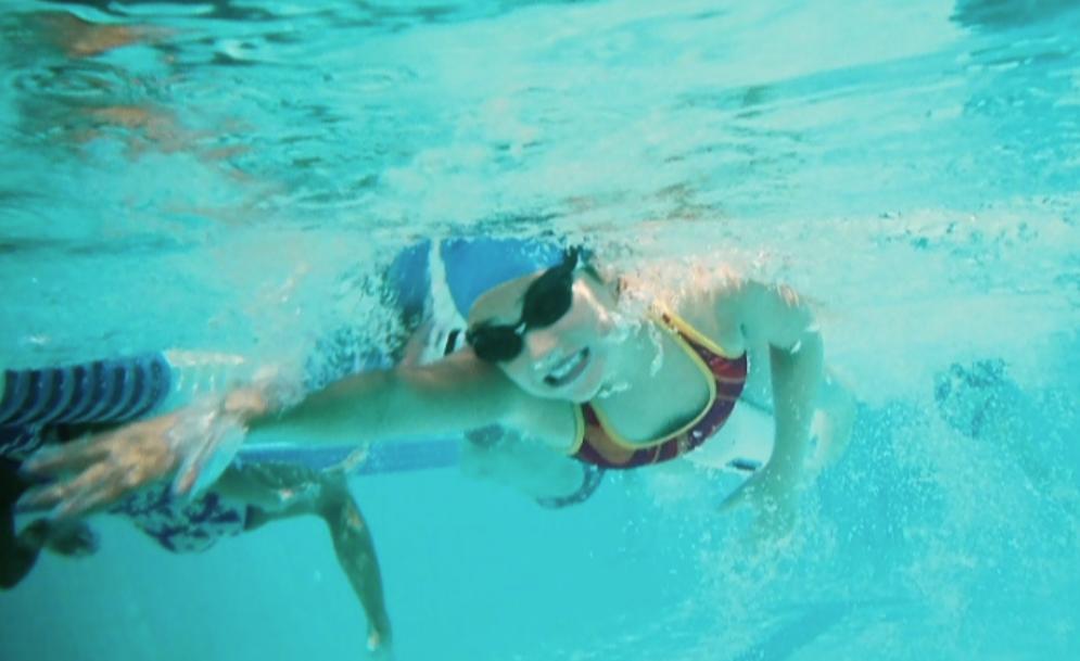 Swimmer gritting teeth
