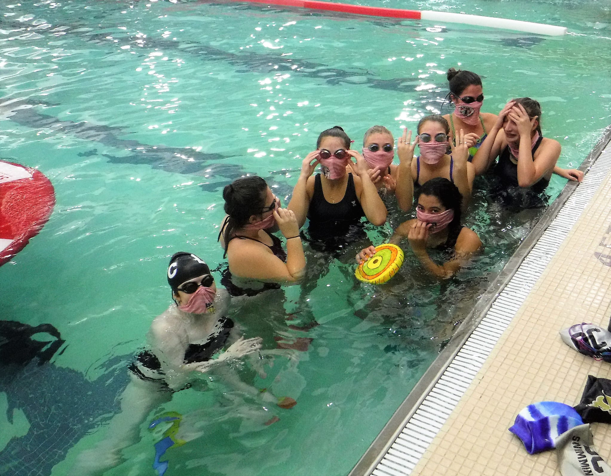 Oakland Catholic swimmers wear facemasks - SKWIM headbands