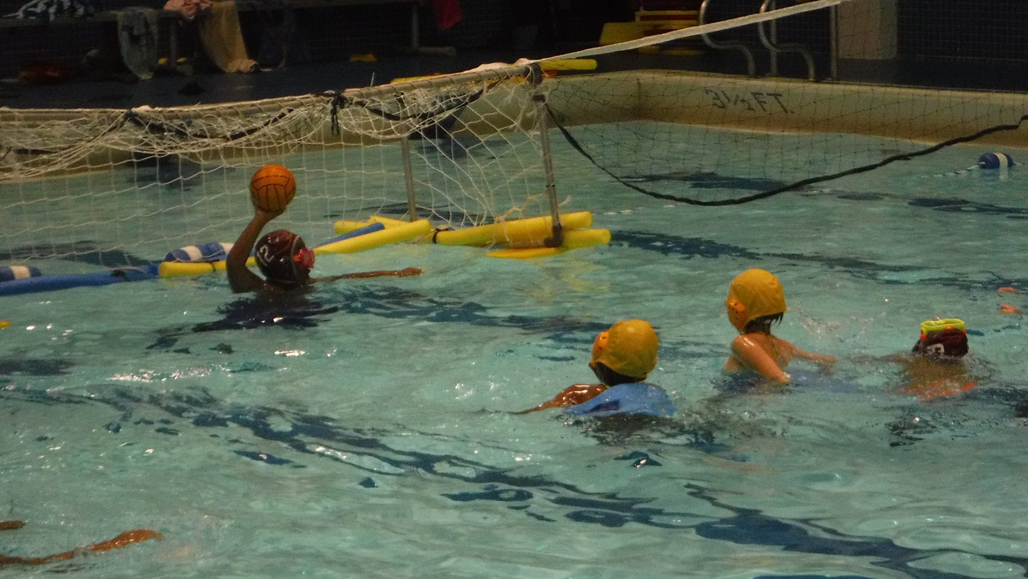 Noodles float water polo goals with rope