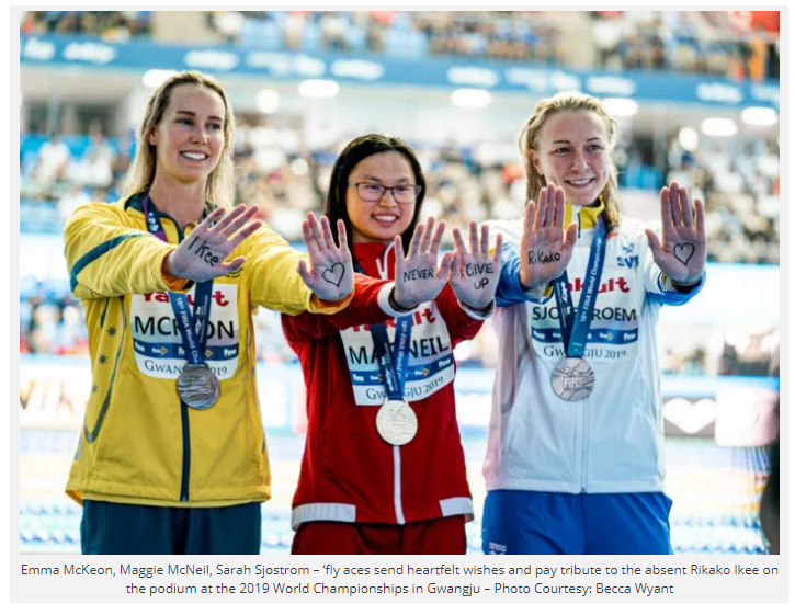 three with medals send message on hands